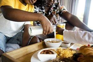 African family eat breakfast in bed