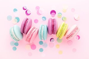 Colorful sweet macarons with confetti.