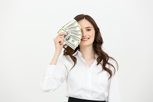 Young happy business woman with dollars in hand. Isolated on white background.
