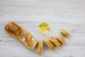Baguette cut in slices with oil.