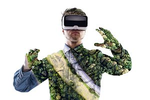 Double exposure. Man wearing virtual reality goggles. Forest. Tr
