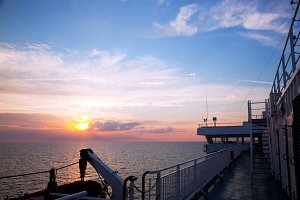 Ship deck, board view at sunset