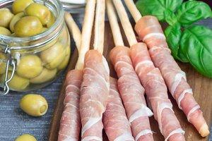 Grissini sticks with prosciutto ham