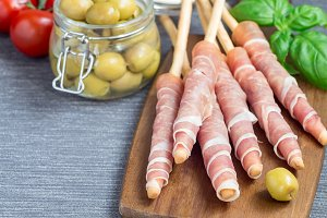 Grissini sticks with prosciutto ham