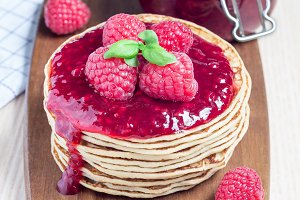 Stack of pancakes with raspberry jam