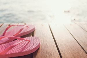 Flip flops at the wooden pier