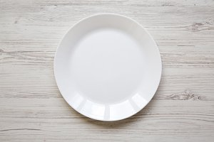 White plate on white wooden