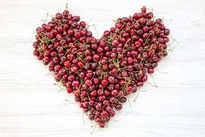 Fresh sweet cherries in heart shape