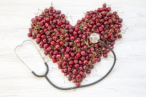 Sweet cherries in heart shape with