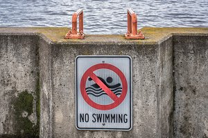 No Swimming Sign on Pier