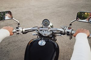 Biker and motorcycle. Hands close up