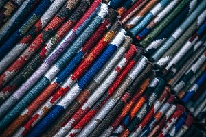 Folded Floor Rugs Stacked in Rows