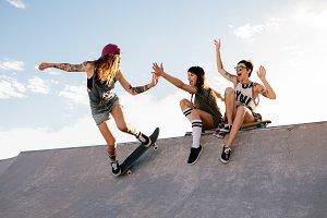 Skater girl riding skateboard