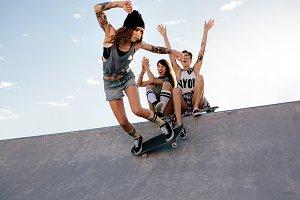 Skater girl rides on skateboard