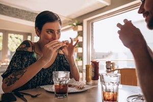 Woman having burger with boyfriend