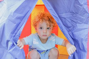 child in a tent
