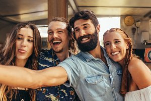 Group of friends making selfie