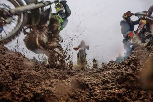 Motocross race among the mud. Risky close-up.