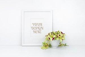 Vertical frame mockup, flowers, cup