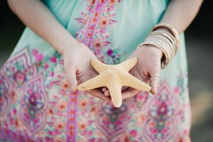 starfish in the hands of a girl