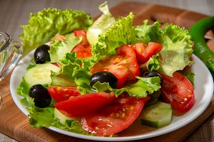 Dish with fresh salad of tomatoes