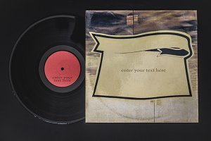 overhead flat lay of vinyl record get out from the box with place for text copyspace on black table mockup