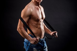 Muscled man with black suspenders