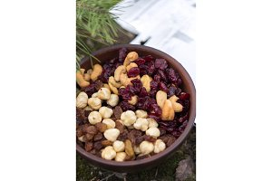 Dried fruits in a clay plate.Mix of nuts and berries in a plate.
