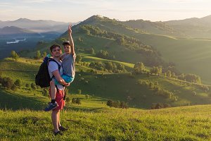 Happy father and son in the Altai mountains