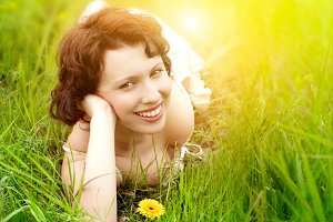 beautiful young woman in grass