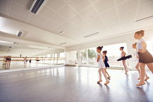 Group of little ballet dancing girls practicing in class
