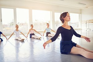 Woman teaching group of girls in ballet class
