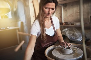 Artisan creatively shaping clay on a spinning pottery wheel