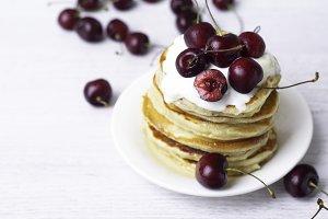 pancake with yogurt and cherry