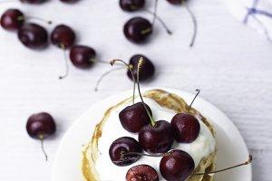 pancake with yogurt and cherry on a