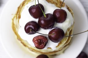 pancakes with yogurt and cherry top