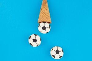 Football macaroons in waffle cones