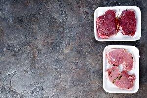 Supermarket packaged porterhouse Lamb meat steaks in styrofoam packaging tray