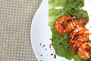 Fresh grilled tiger prawn with korean sauce on white plate