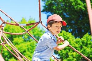 Happy little boy in sport activities