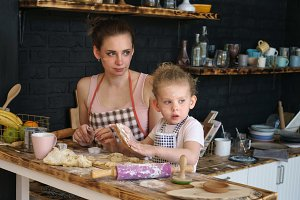 Mother and daughter prepare cookies