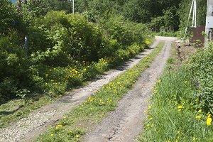 Soil road with broken stones