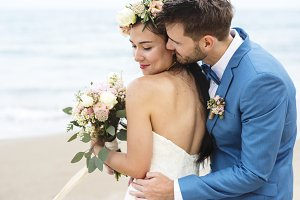 Young couple get married at beach