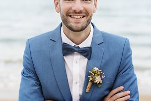 Handsome groom at the beach