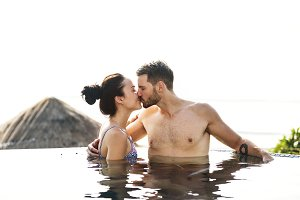 Couple kissing in a pool