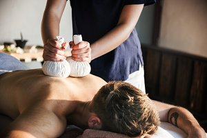 Man having herbal massage at a spa
