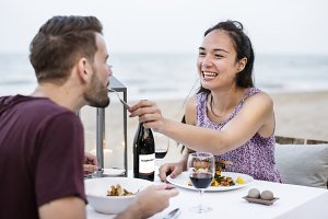 Couple enjoying dinner at beach