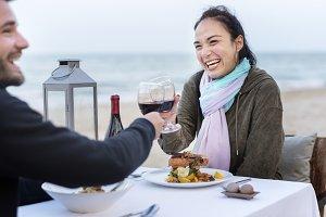 Couple enjoying dinner at beach
