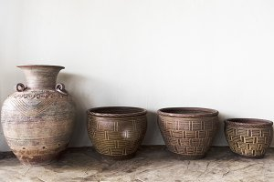 Handmade antique pottery by a wall
