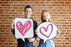 Couple holding bubbles with heart